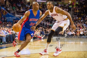 Jodie Meeks #20 of the Detroit Pistons drives around James Jones #1 of the Cleveland Cavaliers during the first half at Quicken Loans Arena on April 13, 2014 in Cleveland, Ohio. April 13, 2015| Credit: Jason Miller